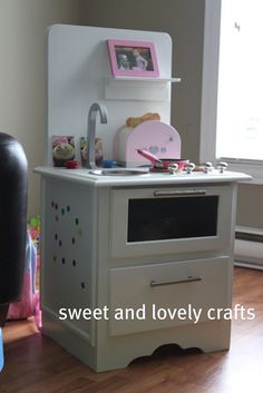 Play Kitchen from upcycled nightstand, wondering if I should squeeze a sink into my current diy kitchen...