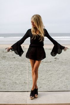 black long sleeve romper with lace ruffle sleeve. paired with cute wedges. daytime or nighttime look. classy hippie
