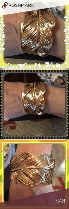 STELLA & DOT Gold Leaf Bracelet Charming gold leaf bracelet will be the talk of the party. What a great statement piece!   Shaped like a leaf and gorgeous. It is not quite 2 inches wide. My wrist is 7 inches and I can barely get it in. Cute and Fancy Stella & Dot Jewelry Bracelets