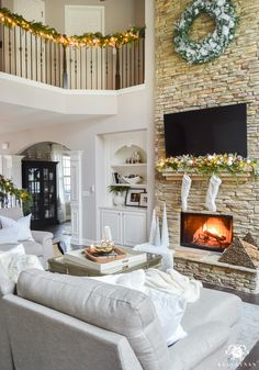 Two Story Living Room with stacked stone fireplace and built-ins ...