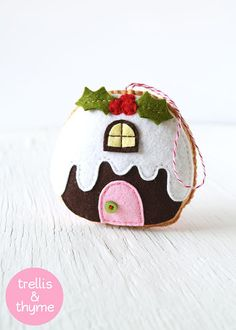 This listing is for an instant-download PDF-PATTERN. It is not a finished toy. The Figgy Pudding Cottage is part of Trellis & Thymes whimsical cottage pattern collection! The Figgy Pudding Cottage ornament is stitched entirely by hand, and is the perfect pattern for adventurous beginners. Finished ornament is approximately 4 inches tall. Skills required: - Basic embroidery skills - Blanket stitch - Back stitch - Stem stitch - Applique stitch This PDF pattern includes: - Materials list - C...