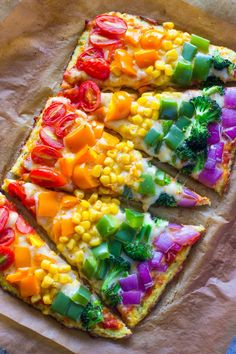 Rainbow Cauliflower Crust Pizza with Tomatoes, Corn, Peppers, Onions, and Broccoli Recipe | Gimme Delicious