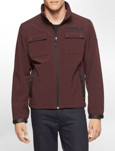 a lightweight, soft shell jacket with a zip front and multiple pockets for organizing.