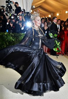 "Rachel Syme writes about the red-carpet fashions of Rihanna, Madonna, and more at the 2018 Met Gala, whose theme was ""Heavenly Bodies. Madonna Fashion, Madonna 80s, Madonna Mode, Lady Madonna, Recital, Madonna Like A Prayer, Madona, Madonna Pictures, Met Gala Red Carpet"