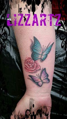Vlinders en een roos