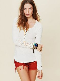 Free People: Crochet Cuff Henley- Long sleeve scoop neck henley with elaborate floral crochet detailing along the sleeves. 6-button placket. Ribbed collar. Shirt tail hem. Features raw seam detailing along the back. $68 (Henna & Silver)