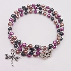 Memory Wire Bracelet, Purple Black &  Brown Glass Pearl Beaded Bracelet, Triple Wrap Bracelet, Butterfly Dragonfly Charm Braclet by EverydayWomenJewelry on Etsy https://www.etsy.com/listing/265289272/memory-wire-bracelet-purple-black-brown