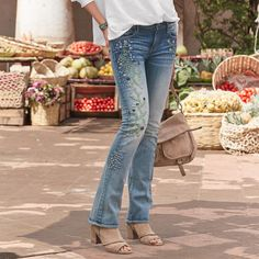 """KELLY BLUEBERRY BLOSSOM JEANS--Meandering, embroidered vines are peppered with cheery blossoms in these figure-loving 'Kelly Blueberry Blossom' jeans by Driftwood in a baby bootcut silhouette. Cotton/spandex. Machine wash. Imported. Exclusive. Sizes 26 to 32. 33"""" inseam."""