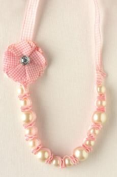 Like the idea of mini fabric flowers on kids necklace