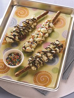 Nutty Popcorn Pretzel Sticks with Chocolate Drizzle - A fun recipe for popcorn pretzel sticks - perfect for lunch boxes, after school treats or parties. Dairy-free and vegan with gluten-free, nut-free options.