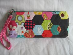 Maybe not the hexagonal patchwork which would be very time consuming, but patchwork of some kind to make a pencil case. Another scrap project?