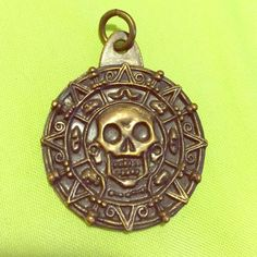 Pirates of the Caribbean Charm Disney's Pirates of the Caribbean coin charm. Free with $10+ purchase from my closet or $6 alone. Let me know you want this item in your order before purchase! Used item, slight wear on metal, nothing noticeable. **All items hand washed, sterilized, and dried before shipping. Smoke free home.** Jewelry Necklaces