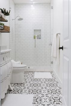 Basement Bathroom Reveal and the Best Tile of 2018 - Oh Sweet Basil Black and white tile bathroom with a dresser turned into a vanity and a tall infinity glass shower with white subway tile, now that's a guest bathroom I want to visit! Black And White Tiles Bathroom, White Subway Tile Bathroom, Bathroom Floor Tiles, Dyi Bathroom, Glass Tile Bathroom, White Tile Bathrooms, Basement Bathroom Ideas, Bathroom Tile Showers, Simple Bathroom