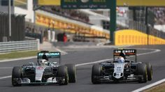 Lewis Hamilton (GBR) Mercedes AMG F1 W06 and Sergio Perez (MEX) Force India VJM08 battle at Formula One World Championship, Rd10, Hungarian Grand Prix, Race, Hungaroring, Hungary, Sunday 26 July 2015. © Sutton Motorsport Images