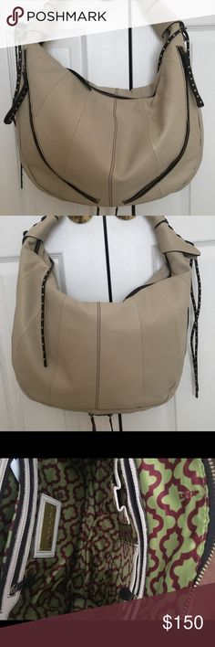 OrYany Jasmine Hobo Beautiful hobo handbag with studs, black whip stitching and multi zipper compartments in the color bone. This bag is boho chic!!! Never carried, not my style but an excellent bag for someone! No offers or trades. Thanks for looking! orYANY Bags Hobos