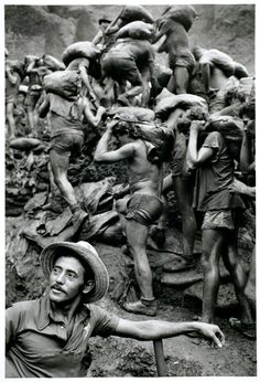 """Throughout his career, Sebastião Salgado has exposed working and living conditions among the world's poor. Salgado recalls the Serra Pelada mines in Brazil, """"Every hair on my body stood on edge. Minimalist Photography, Urban Photography, Color Photography, Documentary Photographers, Famous Photographers, Ansel Adams, Wedding Humor, Magnum Photos, People Of The World"""
