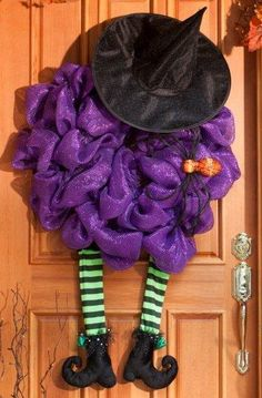 """Smashed witch deco mesh wreath...a fun decoration for """"trick-or-treat""""ers :) #craft #idea #DIY #halloween"""