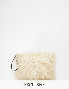 Story of Lola Faux Fur Clutch in Cream