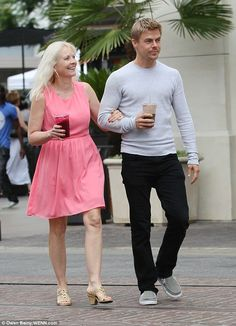 Family time: Derek headed out with his mother Mari Anne in Los Angeles on Friday, where they picked up some drinks