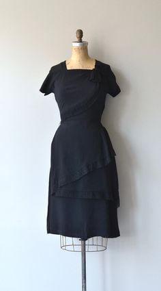 Vintage 1940s black rayon dress with square neckline, short sleeves, lace tiers running diagonally through the bodice and skirt, fitted waist and