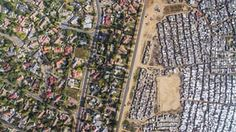 Johnny Miller used a drone to take aerial photographs of the gulf in living conditions for the poor and the wealthy in South Africa