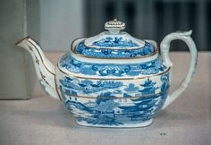 """Porcelain teapot printed in underglaze blue and painted with gold. Printed imitation of Chinese seal-mark and """"C.B. DALE"""". From John Rose, Coleport, Shropshire. About 1812. Norwich Castle Museum"""