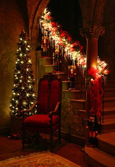 "Nutcrackers on the staircase with a garland of blazing lights. Victorian style for an ""Old Fashioned Christmas"" ."