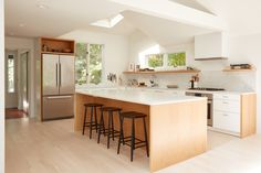 Lisa Jones' Shelter Island House Kitchen Full View, Photo by Jonathan Hokklo IKEA ringhult cabinets with customised oak cabinetry and marble island benchtop