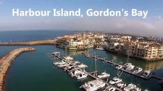 Gordon's Bay is the smallest of three towns in the Helderberg region, so named after the Helderberg Mountain which is part of the Hottentots-Holland Mountain. Cape Town South Africa, Mountain Range, Bay Area, Holland, Coastal, Places To Visit, African, River, Sea