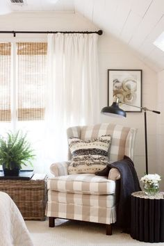 Found that small wood stool at HomeGoods for 49.00!  Major score.Reupholstered wing chair in Buffalo Check.The curtains were ready mades from Pottery Barn that we had small pleats put in (Rods and floor lamp from Target)