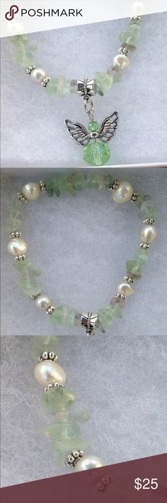 """Green Multicolor Fluorite and Pearl Angel Bracelet This beautiful bracelet is made with natural multicolor fluorite and cultured freshwater pearls. The fluorite is mostly green with tiny hints of purple. The accents are natural freshwater pearls, and the glass angel charm adds a cute touch! This piece is on elastic and will stretch to fit up to a 7.5"""" wrist.   All PeaceFrog jewelry items are handmade by me! Let me know if you need the size adjusted. Take a look through my boutique for more…"""