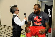 LeBron James being interviewed by a young fan.