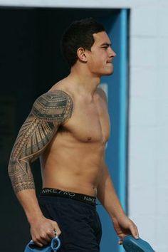 sleeve tribal tattoo...this guy looks like a cross between Paul Walker and Channing Tatum :)