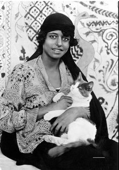 Egyptian woman and her cat, 1923.