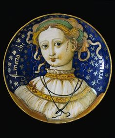 Gubbio, Italy, ca 1535-40. Tin-glazed earthenware with yellow and gold lustre. The head of a young lady with the inscription Amaro chi me amara; I will love whoever will love me. (via VA)