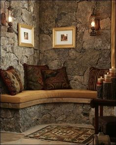 Nice little reading nook and I love the stone walls and lanterns + candles.