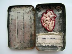 "i love this... though it makes me feel a little sad. a small, rusty tin is no place to keep a beautiful heart. (stitched on the back of the heart is the word ""hope"") <3 m"