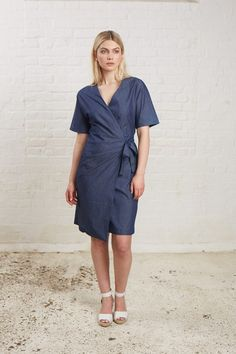 Blue wrap dress in 100% organic certified cotton. Above kneel length with matching tie fastening and short sleeves. Length 100cm.