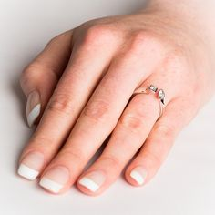 ONLY SIZE L This stunning and unusual 18ct white gold ring has TWO sparkling diamonds set in secure and smooth rub over settings, one is marquise cut and the other princess cut. Elegant and unusual, this ring will make you stand out from the crowd and become the envy of your friends! NOW ONLY £1672.50