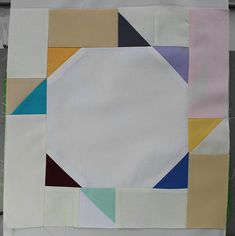Circus Swirl Block Tutorial. This would make a very nice border. You could add more triangles squares and rectangles to make it bigger.