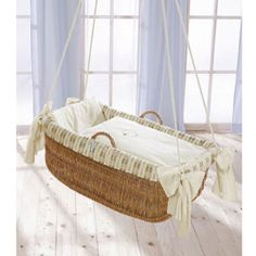 Petite Lamb Hanging Bassinet. Maybe not the safest looking thing, but it's damn cute.