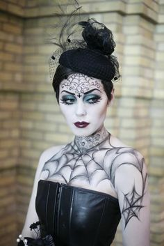 I just love the shadowing on the tattoos (though it's probably airbrushing; they did a good job!).   Elizabeth McLeod's first-place beauty/fantasy student competition make-up at the 2009 IMATS Toronto. Photo by Deverill Weekes.     Source: http://www.imats.net/toronto/photo_gallery.php?=toronto=5#http://www.imats.net/photos/20091122142503_MG_7591.JPG — with Ford Fatale and Alessandro Simeoli.