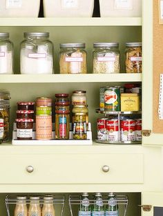 Put canned goods in clear view with tiered shelf organizers. See 16 more kitchen storage tips: http://www.bhg.com/kitchen/storage/organization/kitchen-storage-solutions/#page=7