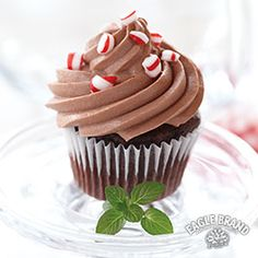 Spread some holiday cheer with these delightfully sweet Chocolate Peppermint Mousse Cupcakes. #SweetenTheSeason
