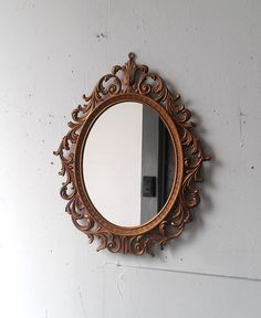 Vintage Mirror in Golden Bronze Oval Frame 16 by 12 inches