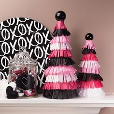I wasn't sure about black for Valentine's Day when I saw it in the stores, but I really like it paired  with pink in these Tissue Paper Fringe Topiaries. These are over #ontheblog - just search for Tissue Paper Fringe Topiaries. #crafts #valentinesday #tissuepaper #fringe