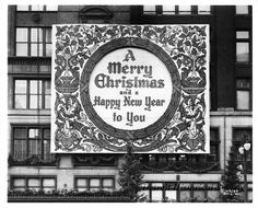 "The sign features holiday ornamentation and reads, ""A Merry Christmas and a Happy New Year to You."" Holiday trimmings, including garland and Christmas trees also adorned the exterior of the department store."