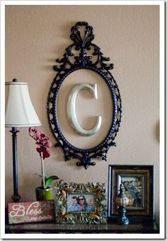 Old mirror/picture frame, spray-painted with initial in the center. Cute for office or entryway.