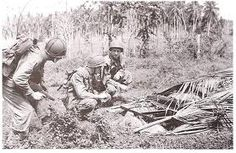 Marines cautiously inspect a bunker in Guadalcanal. What was supposed to be a short battle dragged on for six bloody months.