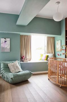 MODERN BABY NURSERY: pretty calming aqua blue-green walls, light wood crib, loving the rocker looks so comfy #baby #newborn #nursery